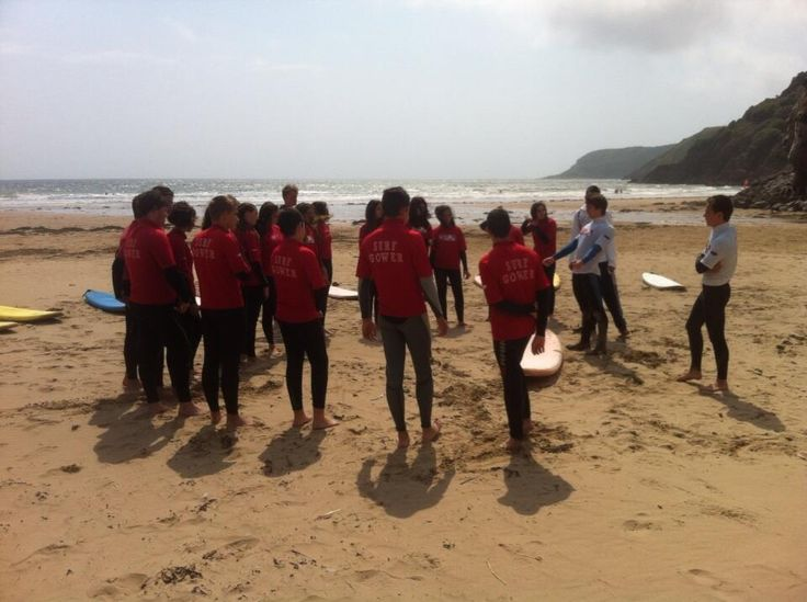 Swansea Uni students learning to surf at Caswell (one of our local beaches) with SurfGSD