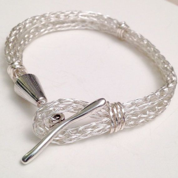 The ancient wire technique known as viking knit creates a light yet strong chain. In this bracelet, a double length of non tarnish silver chain is