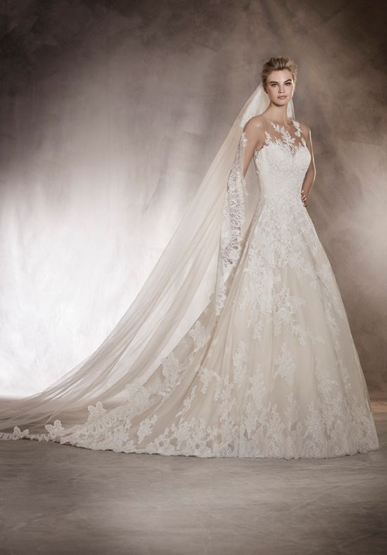 An Illusion Neckline Wedding Dress In A Line Silhouette With Cascading Lace Appliques Beads Featuring Open Sheer Back Detailing