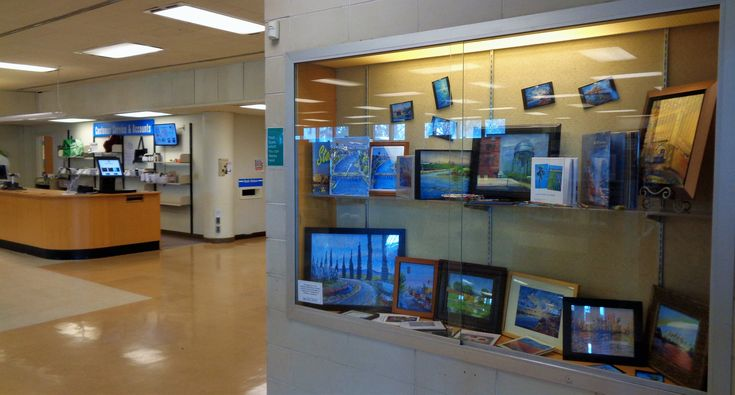 Small works, archival prints, and books in the main entry wall case, Cesar Chavez Central, San Joauqin Public Library, Stockton, California.  Copyright (c) Vanessa Hadady