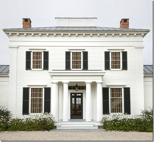 White house with black shutters and black door