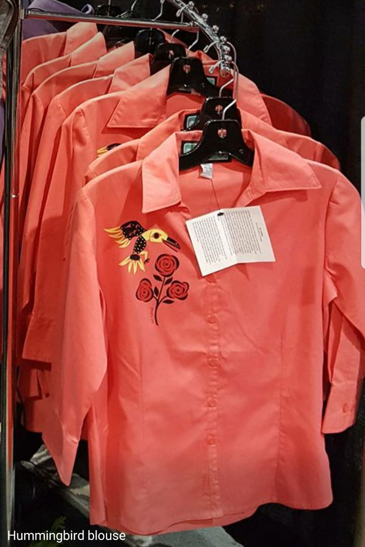 AVM Museum Shop:  Hummingbird Blouse by Ay Lelum – The Good House of Design, a second generation Coast Salish Design House.  ¾ sleeve coral blouses with hummingbird design; cotton/poly blend.