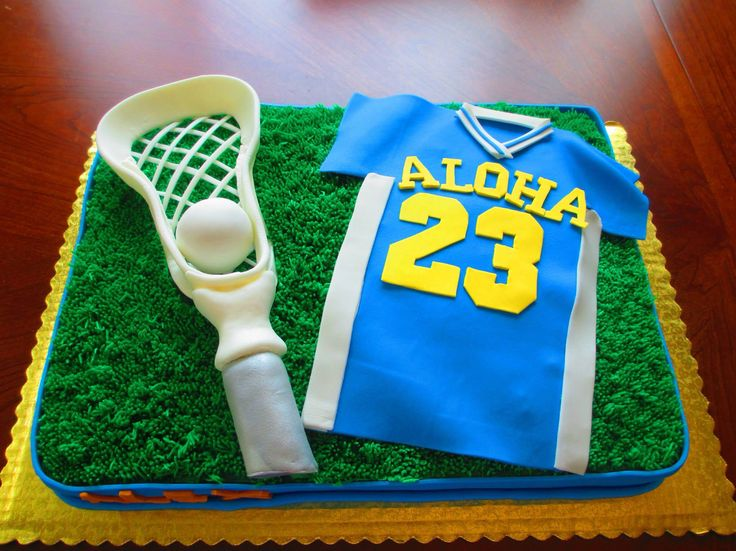 Lacrosse Cake - Jersey, stick and ball made of fondant with grass frosting.