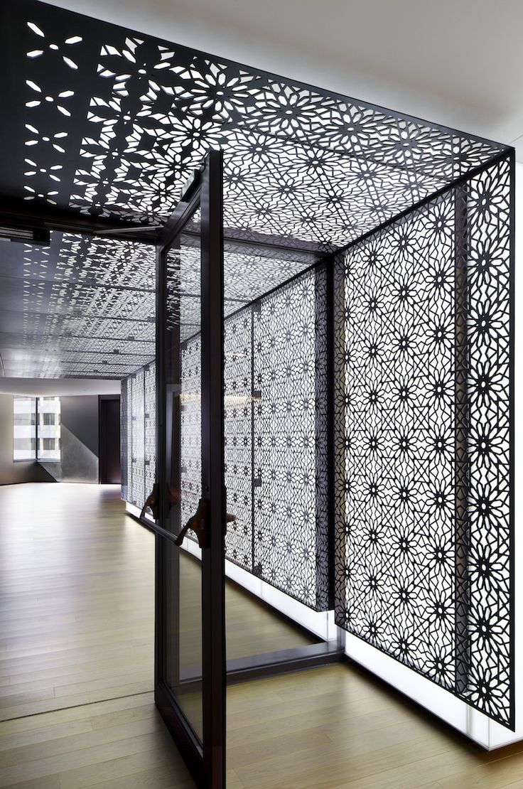Custom element by Eventscape for KAUST in Jeddah, KSA.  It's a thin profile polymer LED light wall and ceiling & is overlaid with laser cut and etched steel panels.
