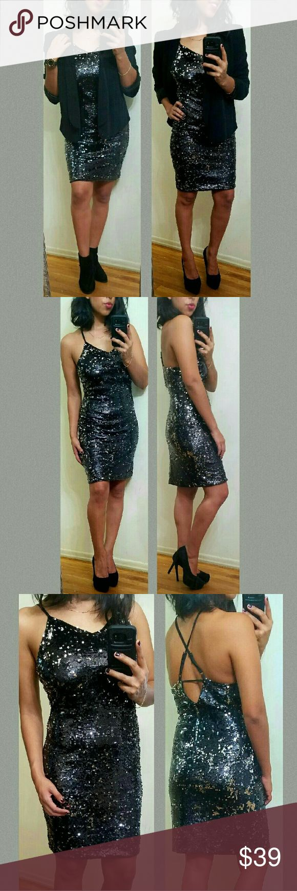 🎁FLASH SALE🎁BLACK SILVER SEQUIN DRESS Ladies get ready for the holidays in this super sweet yet sassy Silver and Black sequins dress.Features all over sequins (which don't poke through the dress!) Criss-cross back. Adjustable straps with hidden back zipper. V neckline. Lined. It's a stunner! Add a blazer or coat to stay warm**not Lulu's, it's similar.   •Fabric Content: both shell&lining are 100%Polyester  •Sizes available S M l •MODELING SIZE MEDIUM •  ●•••》PRICE IS FIRM UNLESS…