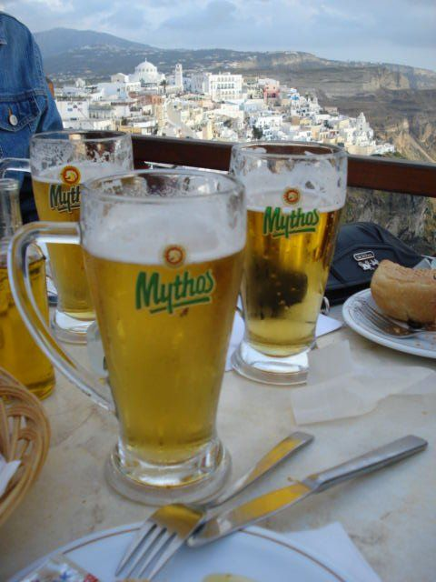 Greek beer and soulvaki at the peak of Santorini, Greece