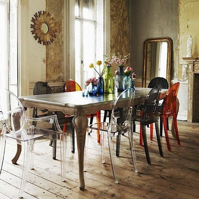 Dining room with Kartell Louis Ghost Chairs by French designer Philip Starck