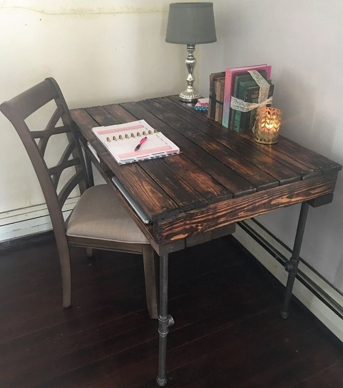 This amazing pallet wood table is perfect for your small study corner. Attach steel pipes with the base as legs which will add to the strength and durability of your vintage pallet wood table. Make a place for your files and folders underneath the wooden top. This dark brown polish has enhanced the beauty of your study table.