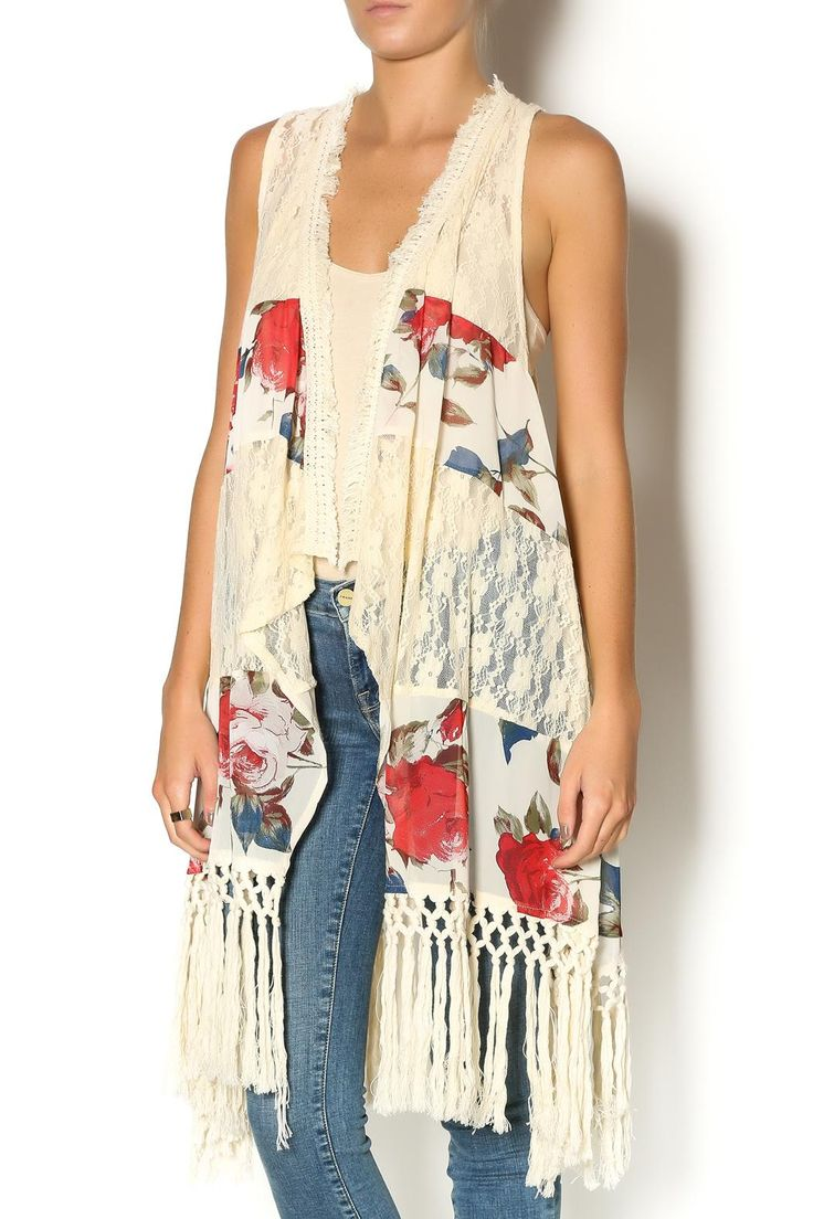Longopen cream vest with a floral pattern on panel inserts, lace backand fringe bottom. We love this look with skinny jeans some booties. Floral Fringe Vest by Ryu. Clothing - Jackets, Coats & Blazers - Vests Ohio