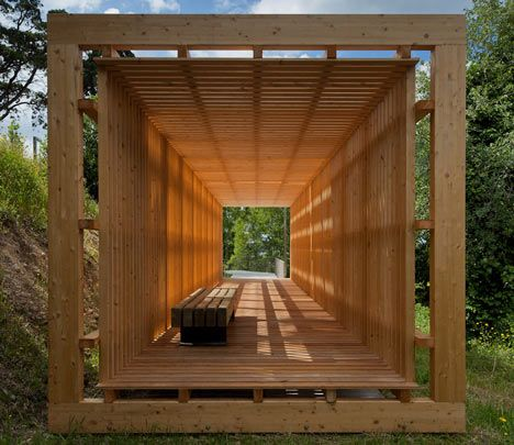 """Pombal Castle Hill by Comoco Architects (Portugal). """"Located near the bottom of the hill, the rectangular timber pavilion is constructed from evenly spaced wooden slats""""–from dezeen.com"""