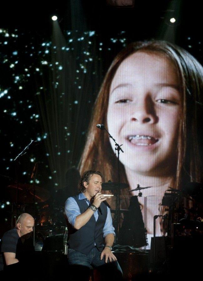Mooie foto van Marco en op de achtergrond Jada zijn dochter