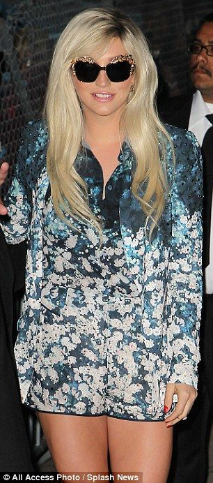 Kesha. Seen this picture in Glamour- she paired the body suit with nude heels. Very chic.