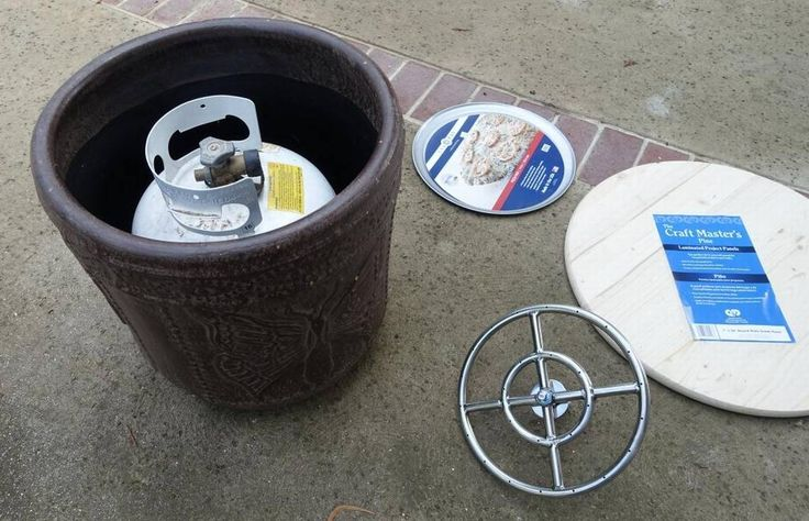 Outdoor propane fire pits sold at patio furniture stores can be expensive, and wood-burning ones are bad for our air quality. But if you're handy with a few simple tools, you can build a cleaner-burning propane fire pit for a lot less money in a snap.