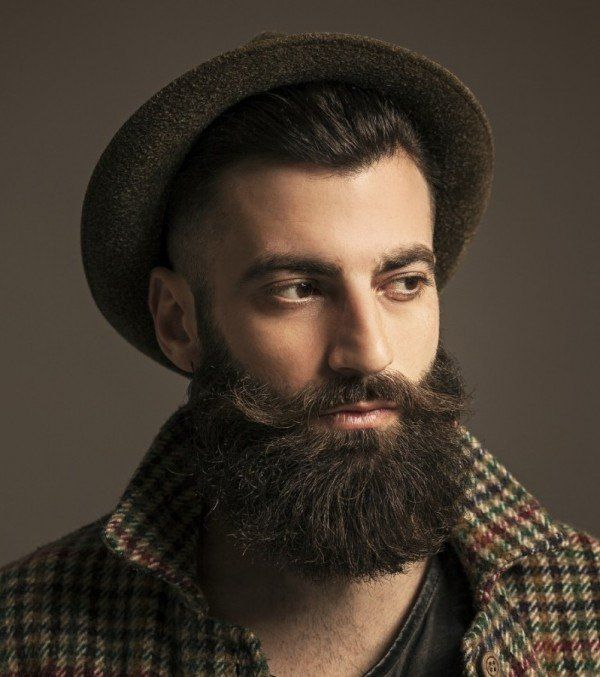 man with beard and hipster hat.