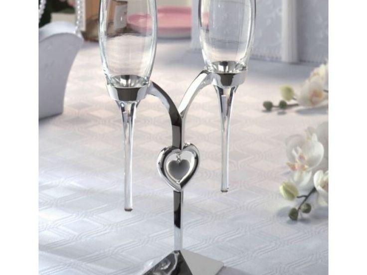 Pahare sampanie din sticla pe suport placat cu argint in forma de inima  Dimensiuni: 30 cm H Poti achizitiona si setul de servire tort din aceeasi colectie!