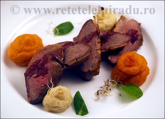 Duck breast with mashed potatoes and sweet potatoes, served with sour cherry sauce