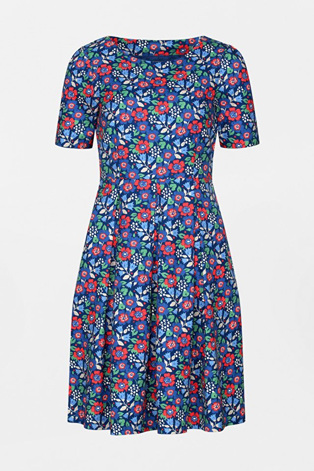 A feminine, '50s-style knee-length dress in cotton moss crepe fabric with a unique Seasalt print, which drapes beautifully for an elegant, retro silhouette.