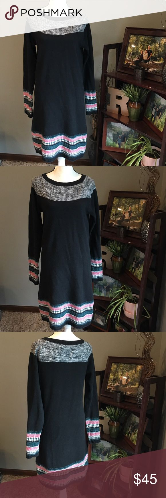 "Athleta Fair Isle Stripped Black Sweater Dress Athleta Fair Isle Stripped Black Sweater Dress.  Size large.  Black dress with Nordic fair isle trim on bottom of dress and cuffs of sleeves.  Fair isle trim is pink, white, green, black, and silver.  Scoop neck sweater dress with grey trim around the neck line.  Made of 75% cotton, 20% nylon, and 5% Cashmere. Measures about 19"" across the chest laying flat and about 40"" long from shoulder to bottom hem. Very beautiful and perfect with a pair of…"
