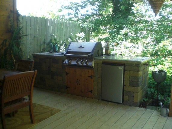 outdoor kitchen with napoleon grill concrete countertop and a very unique sink by