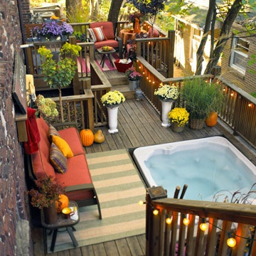 The garden patio offers the comfort of soft furniture and luxury of a small built-in floor bathtub.