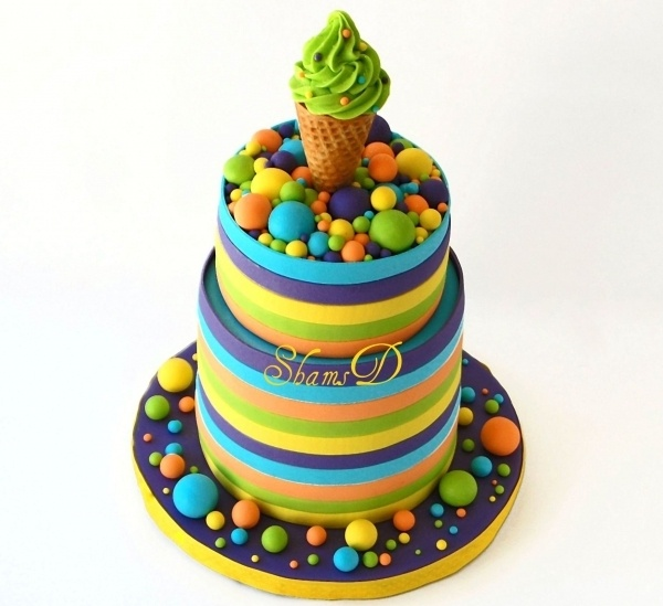 Striped cake. Fun colors!   (I love the fondant gives even if I hate the taste!)