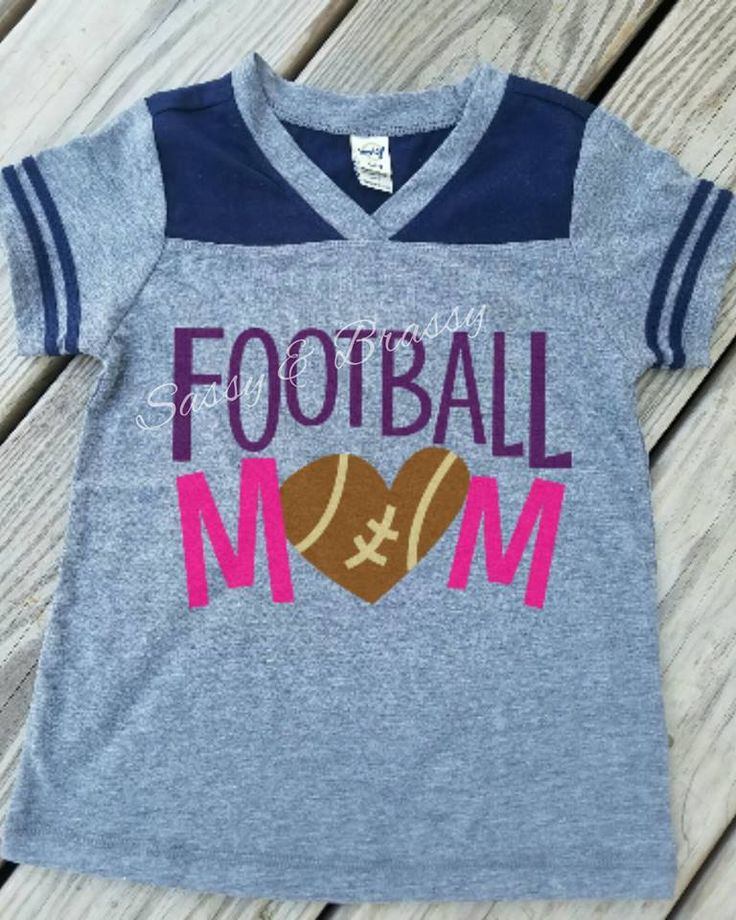 Football Mom Customized HTV Shirt.  For the Sporty Mom who knows how to get dirty.  One of the Guys. Order Here:  http://sassybrassycustomcreations.com/products/customized-football-mom-shirt HMD Groupie, Kavio