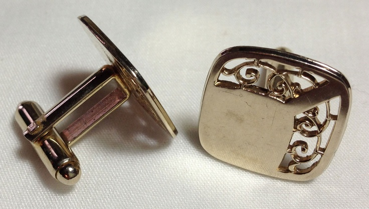 Cufflinks that belonged to my Dad. I believe they're circa the 70s. No idea what materials.