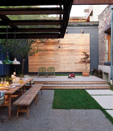 inspiring, modern outdoor patio. Great wood detail on large, plain back wall for added texture and warmth.
