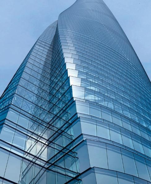 """The Shanghai Tower, a """"self-contained city"""" will include a world-class office, hotel, entertainment, retail and cultural venues. The twisting, asymmetrical shape of the tower reduces wind loads on the building by 24 percent, reducing the structural load on the building. The building's spiraling parapet collects rainwater, which is used for the tower's heating and air conditioning systems."""