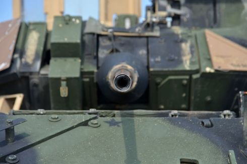 Looking down the barrel of a Bradley Fighting Vehicle's M242 gun prepositioned at Coleman Barracks in Mannheim, Germany. (Michael Abrams/Stars and Stripes)