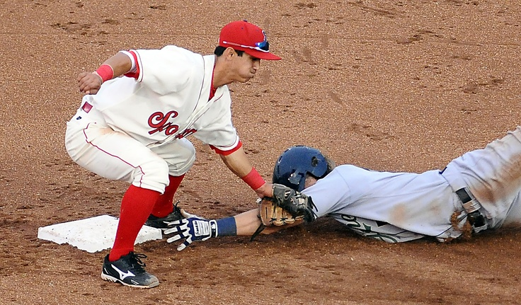 July 13 - Indians shortstop Gabriel Roa tags out the Emeralds River Stevens in Spokane's 4-2 loss to Eugene.