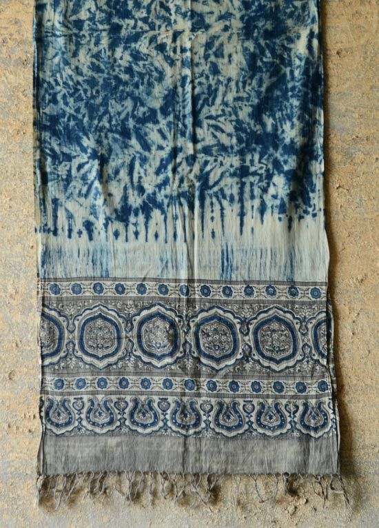 This summer, when the eccentric sun puts a slow blur on your creativity, turn to these indigo masterpieces, where the artisan has combined Ajrakh's aesthetic acuity with Shibori's harmony. As fresh as splash of water, picked from overbrimming streams, the mul cotton of these stoles will make you bask in the sun with ever new zest and vision.  http://shop.gaatha.com/ajrakh-stole-natural-dyes-qcz