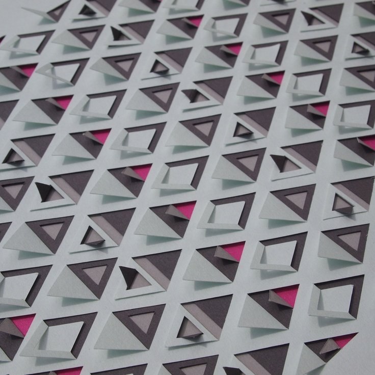 Triangles - geometric pattern created by layered paper with cuts and folds