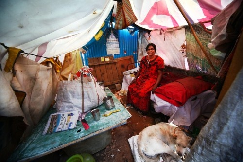 Mary (45) used to run a shop at EWS Ejipura earning Rs. 200 /day. After the demolition she can't even earn 50 rupees a day. Having shut shop, she is now unemployed and lives over a drain, in her tent.  More than 7000 people have joined the campaign to support the cause of many more like Mary asking Maverick Holdings to cancel this deal to build a shopping complex. http://change.org/ejipura  Photo Credit: Hari Adivarekar