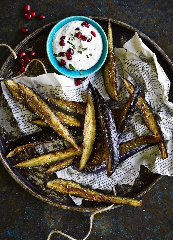 Fried aubergine sticks with sumac and honey: Easy aubergine sticks designed to impress your friends and family as a quick dinner-party starter, or as part of an easy lunch. With a minty yogurt dip, this Mediterranean-inspired recipe with sumac and za'atar just needs a drizzle of honey to finish it off.