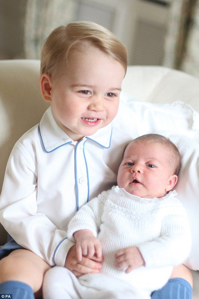 Close bond: Little Prince George looks thrilled to be left in charge of the blue-eyed Princess Charlotte - 6th June 2015