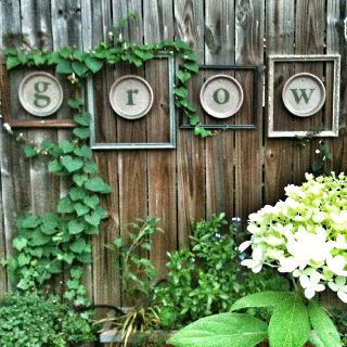 what a creative idea for your garden fence...picture frames with paint can lids and letters painted on each to spell whatever you wish!