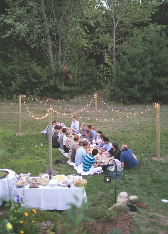 Oh my gosh! You can hang adorable lighting for a backyard soiree even if you don't have trees!