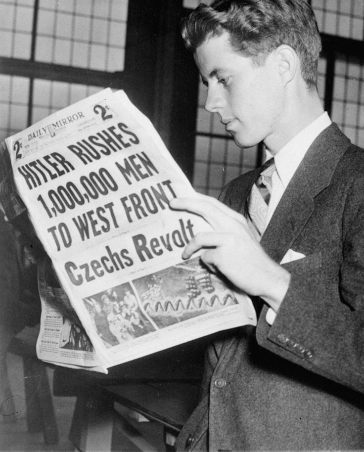 John F. Kennedy, just returned from Berlin and London, reads the news, 1939. (AP Photo)