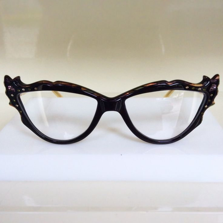 Gorgeous deep chocolate acetate frame from Francis Klein with hand stoned crystals!