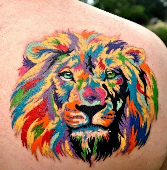 Lovely coloured lion head tattoo on shoulder blade