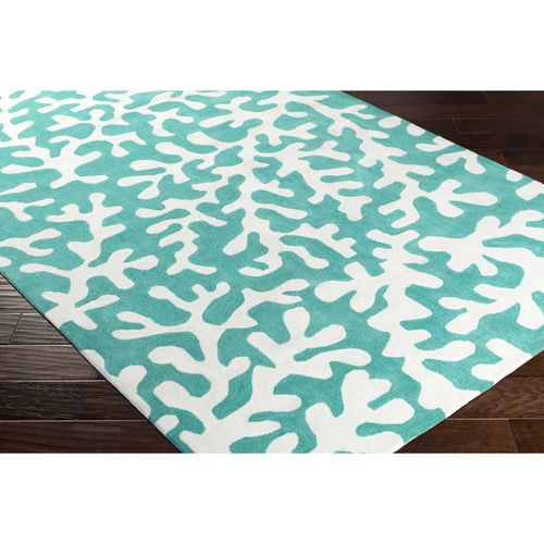 A perennial favorite color shade for beach homes, this teal background plush area rug with undersea light gray coral images will be the highlight in any room in your home!