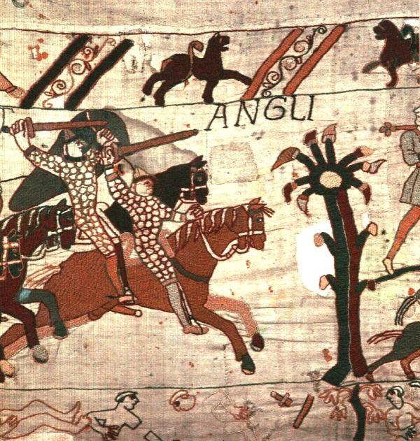 Het tapijt van Bayeux is een borduurwerk van 70 meter lang en 50 cm hoog, dat de geschiedenis uitbeeldt van de slag bij Hastings in 1066. Hierbij viel Willem de Veroveraar vanuit Normandië Engeland binnen en versloeg hij de Angelsaksische koning Harold. Het tapijt is vernoemd naar de stad Bayeux in Frankrijk en werd vermoedelijk vervaardigd tussen 1066-1082. Detail 58