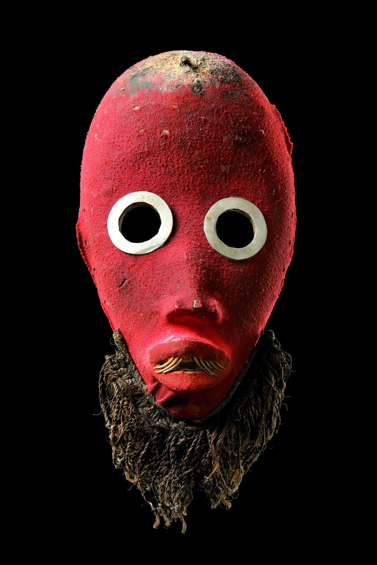 Running mask.  Zakpai, Ivory Coast, Dan, 20th c. Fabric covered wood, aluminum rings, fiber, teeth inset with pointed animal claws. Private collection, France.