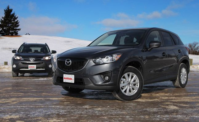 The CX-5 wins again!  2014 Mazda CX-5  vs 2013 Toyota RAV4 http://www.autoguide.com/car-comparisons/2014-mazda-cx5-vs-2013-toyota-rav4-2499.html