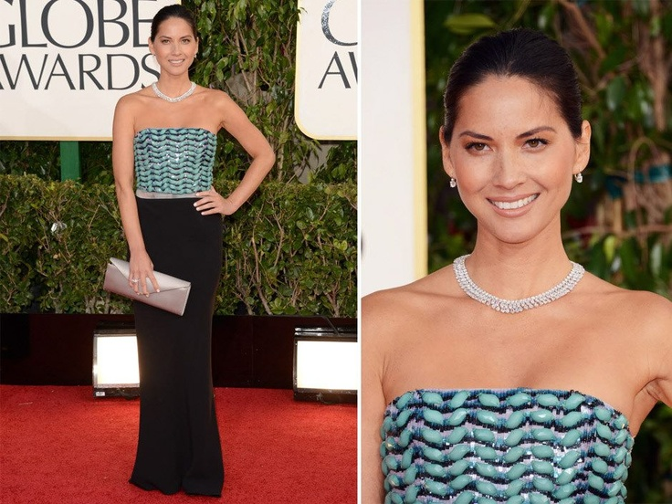 Olivia Nunn arrived in Giorgio Armani dress, shoes and bag completing her look with a Chopard jewels.