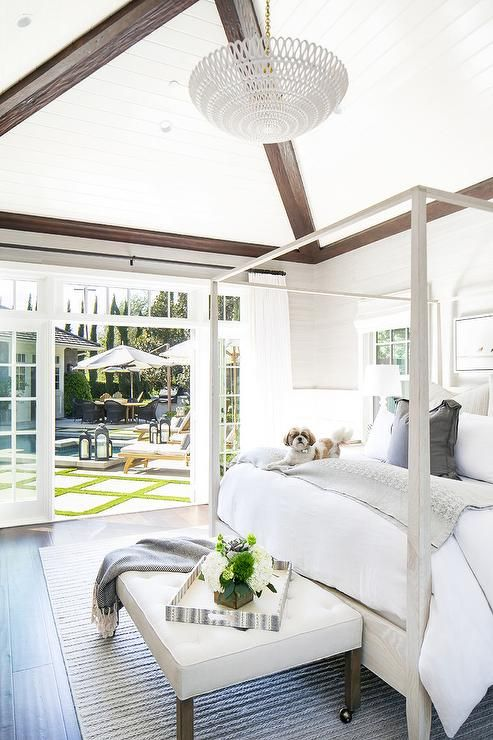Canopy bed, Hamptons style, coastal style, all white bedroom, striped rug, master bedroom ideas - ABSOLUTELY GORGEOUS & IT SEEMS THE DOG AGREES, SO MUST BE SO COMFORTABLE AS WELL AS STUNNING!⚜