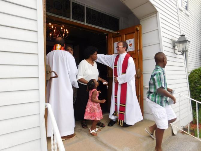 The Rev. Kazimierz Bem greets worshippers leaving First Church in Marlborough, Mass., following an ecumenical prayer service on June 3(Photo: First Church/Barbara Parente).