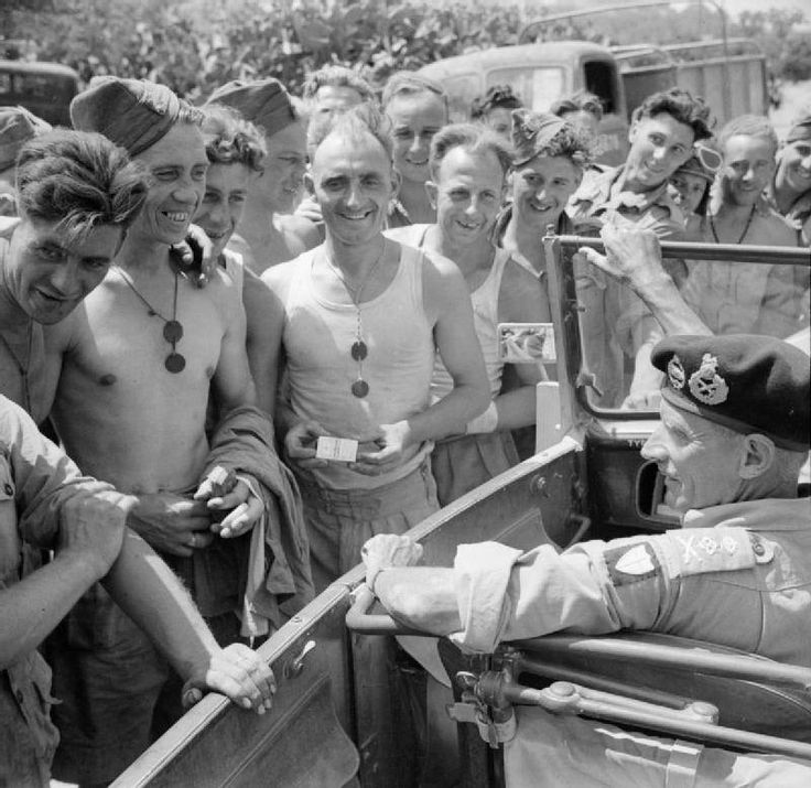 General Montgomery stops his car to talk to Royal Engineers working on a road near Catania, 2 August 1943