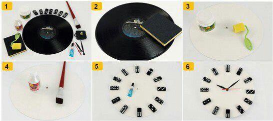 Reloj de pared hecho con disco y fichas de domino